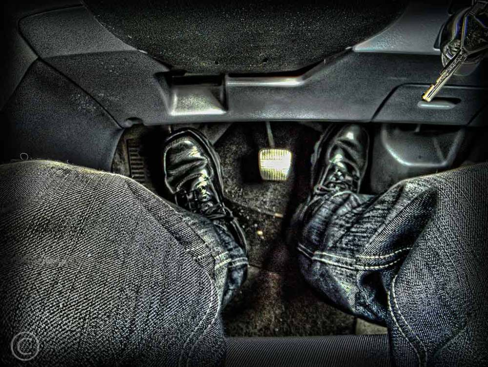 Curly's feet and brake pedal