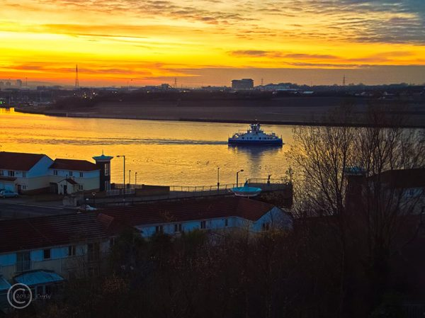 The Shields ferry on the river Tyne at sunset.