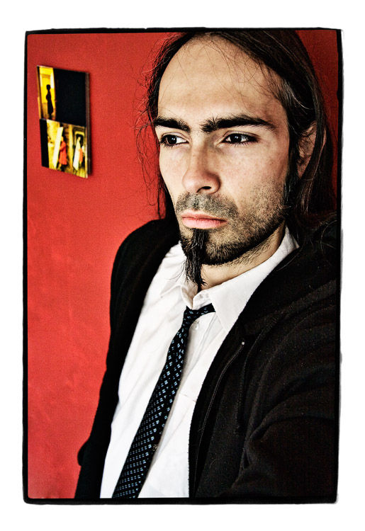 camera-bodybuilding with tie and red wall