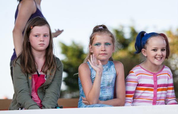 Three children of varying cheerfulness