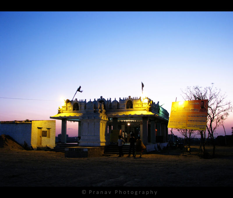 a small temple on the neighbourhood hill top
