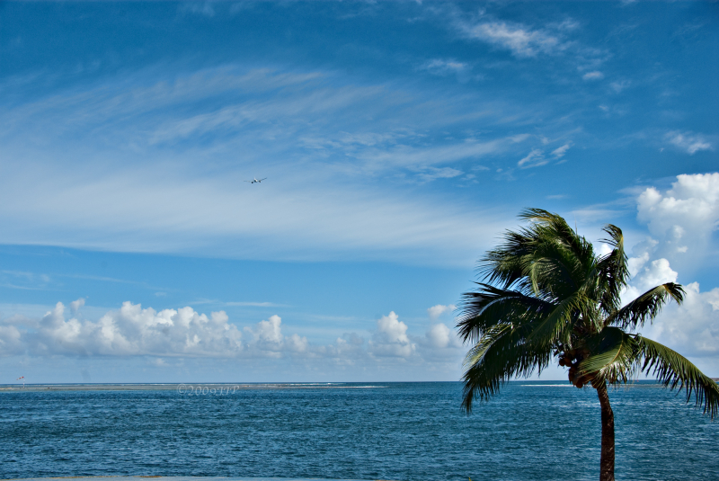 A plane flying away from Tahiti