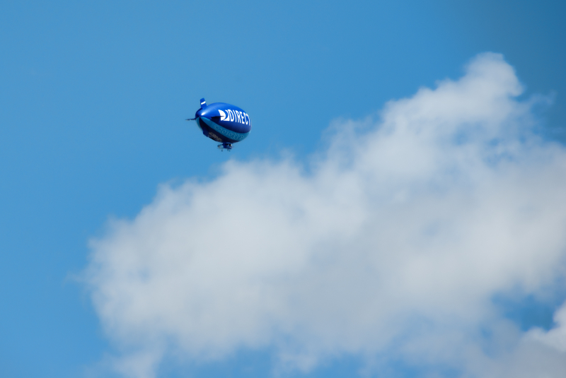 a blimp heading into the clouds