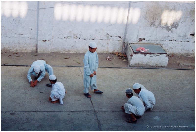 Kids playing outside the Masjid