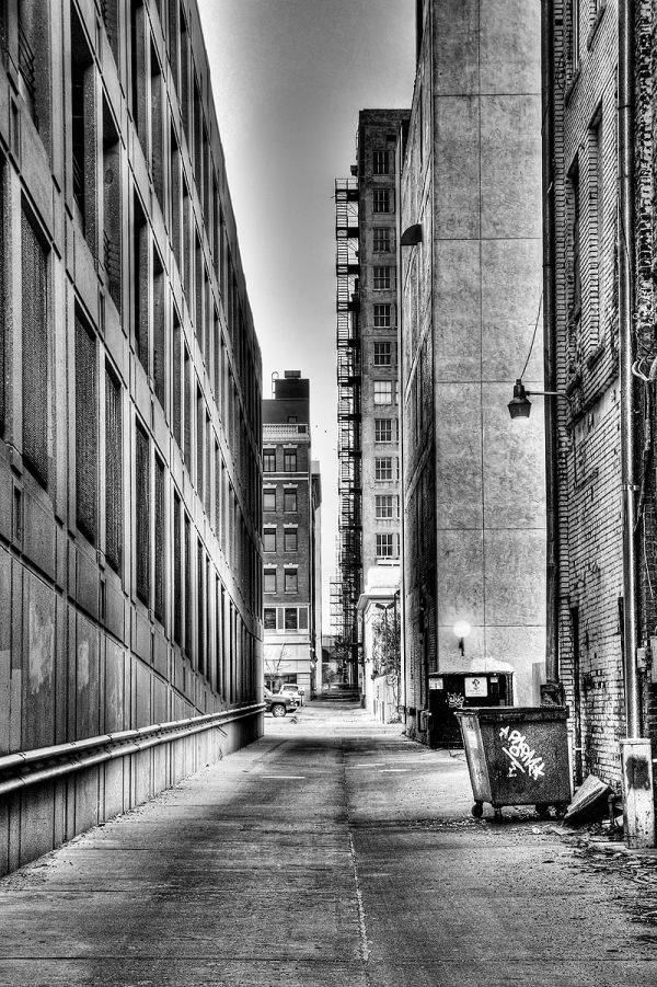 black and white view up downtown alley near sunset
