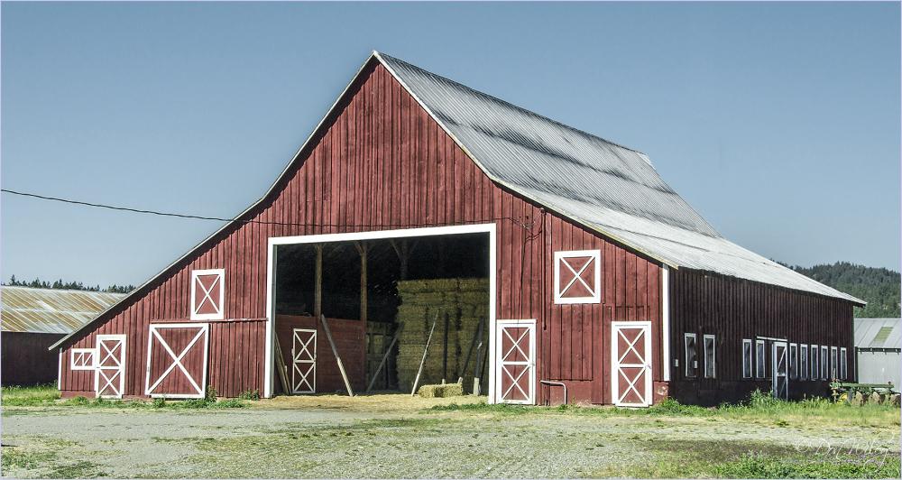 A barn featuring X