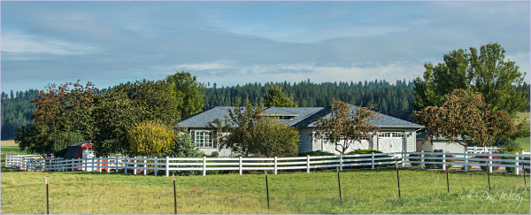 Farm Home With Fence
