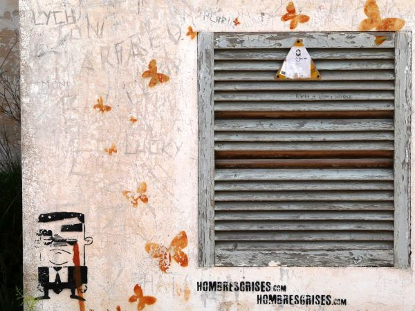 Graffiti de hombre trajeado en pared