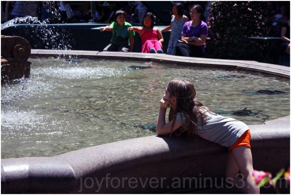 child girl daydreaming fountain
