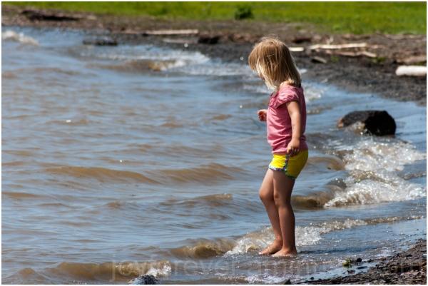 girl child toddler wading water Cayuga Lake NY