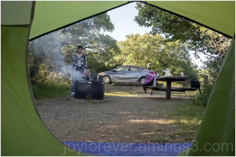 camping tent door breakfast cooking campfire