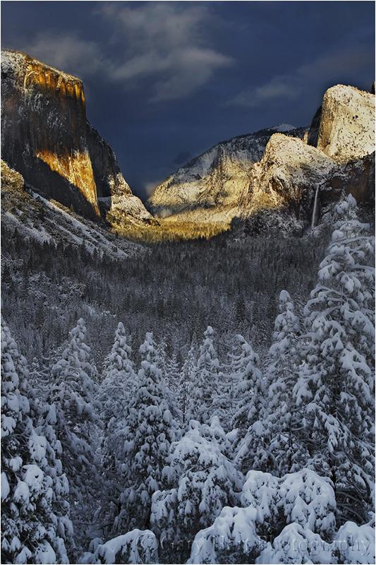 Warn light bathes snowy Yosemite Valley