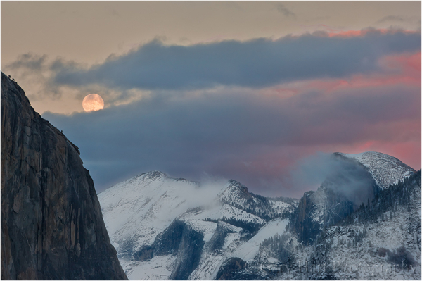 Moon rising above a snow-covered Yosemite Valley