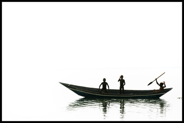 Ugandan boys on a boat