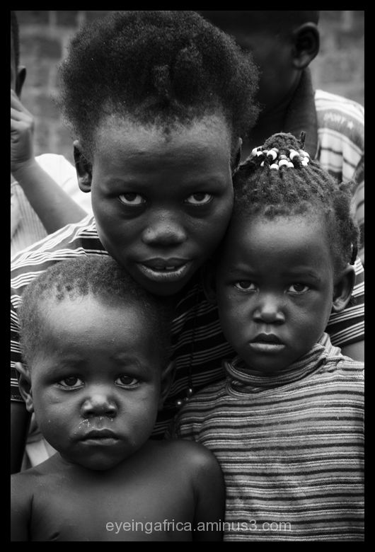 Mother with Children in Kampala Slum