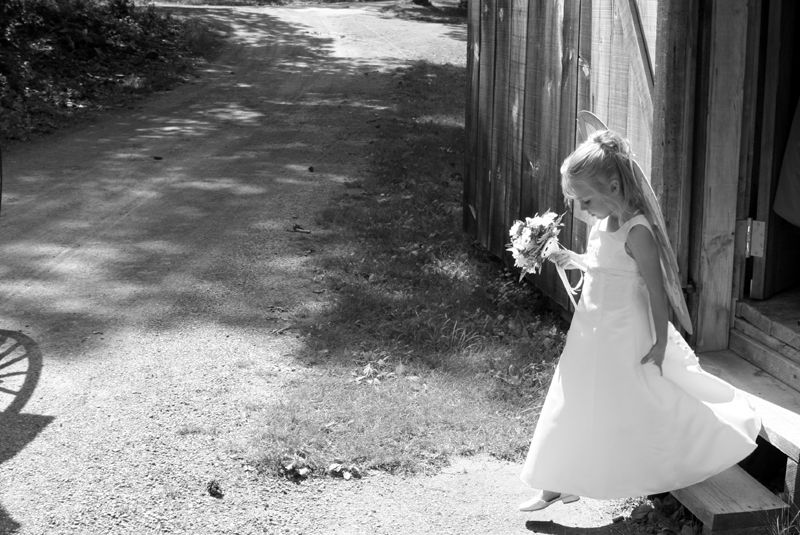 a flower girl steps out