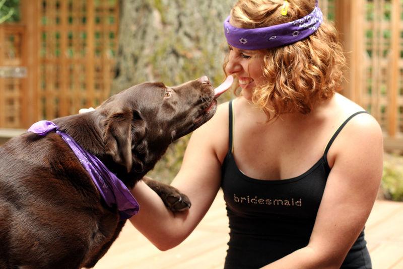 a dog licking a girl's face