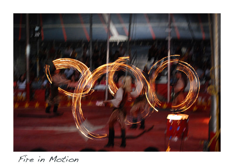 A circus picture of fire twirlers