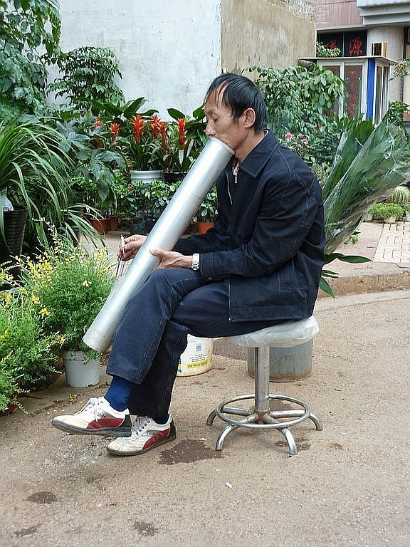 water pipe smoker in Yunnan