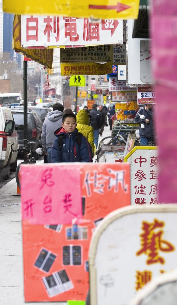 kid walking in chinatown