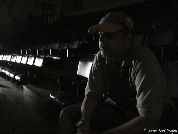 man in empty cinema theater