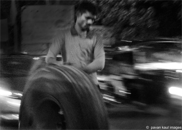 man toiling on street at night