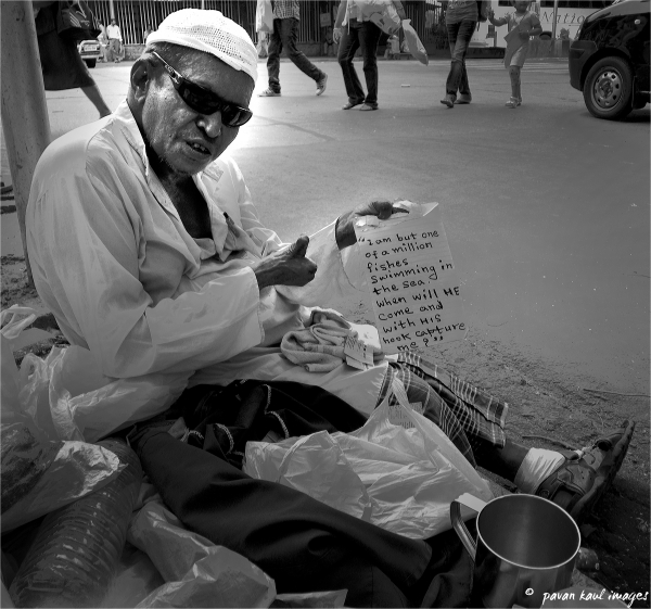 Portrait of Philosophical beggar on street