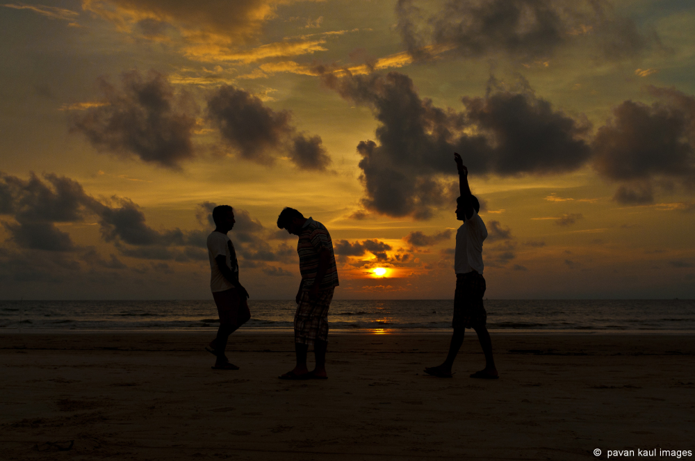 boys on beach at sunset