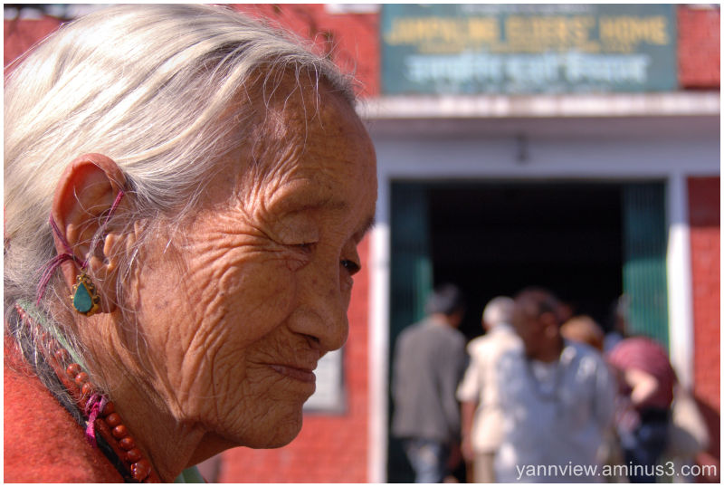 Portrait of an Tibetan woman at old folk home