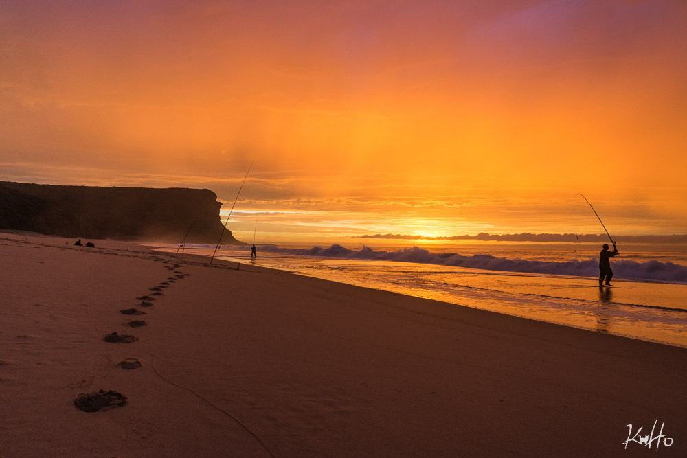 Fishermen at sunrise at Garie Beach