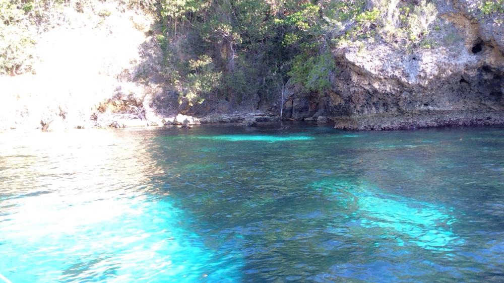 Transparent blue-green waters near Calintaan Cave