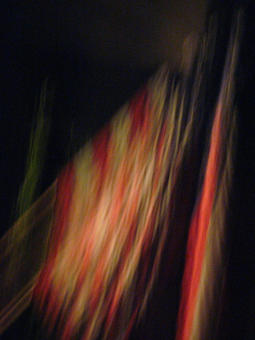 American flag in the abstract, flying at night