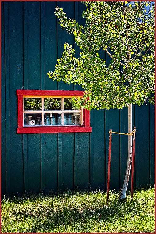 red-trimmed window   . . .