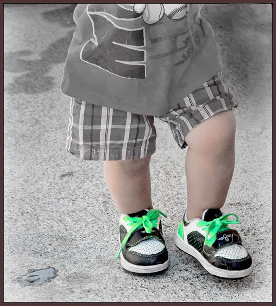 toddler with green laces   . . .