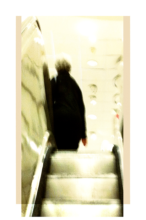 woman going up escalator   . . .