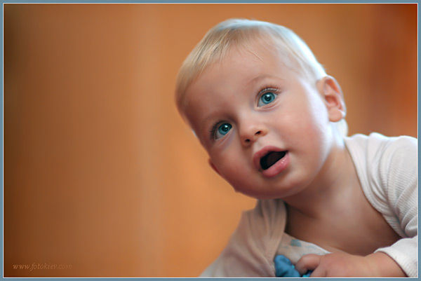 Little boy with blonde hair and blue eyes