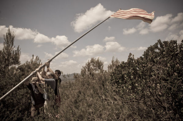 Raising the flag in Sant Miquel