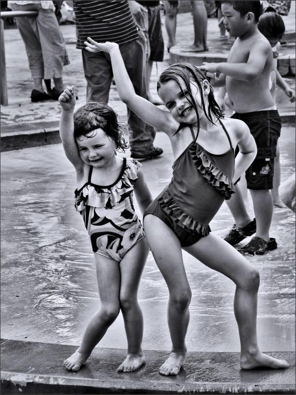 Girls Posing on a Pool
