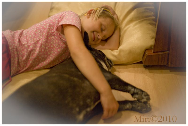 A girl and dog are sleeping