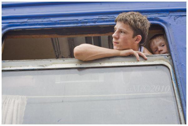 two boys at the ukrainian train window