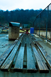 bench cold dark garbage reflection