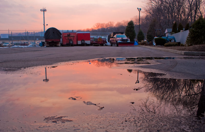 sunset reflection tress trucks