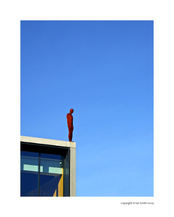 Anthony Gormley figure on The Roundhouse, London