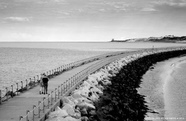A young couple strolling in Herne Bay, Kent