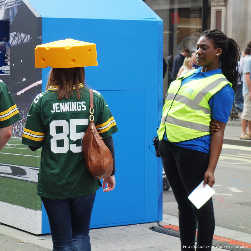 A woman wearing a cheese on her head