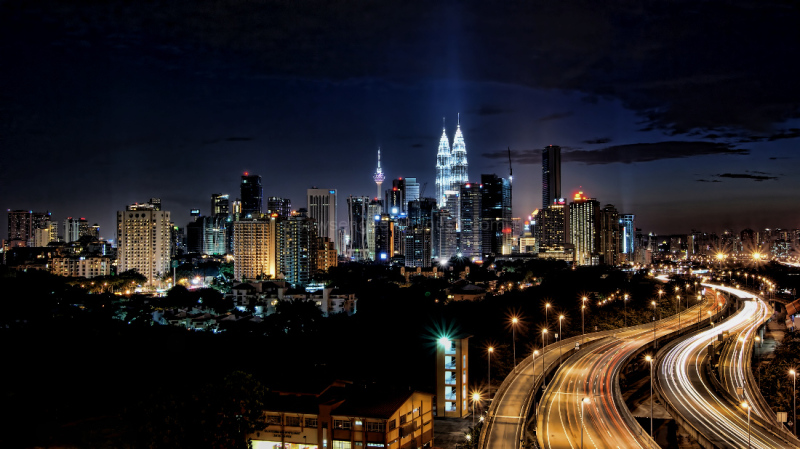 Kuala Lumpur, Malaysia, Picture taken on the evening of 5th of May 2012.....showing the splendour of the city skyline at the expense of sky pollution.   The vertical uplights, dust in the atmosphere & high vapour densities rob the urbanites the chances of seeing the beautiful stars in  the night.