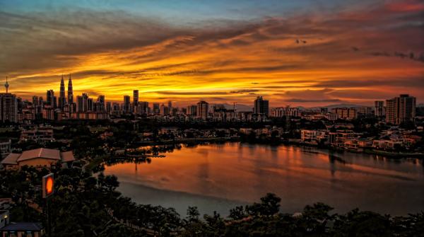 Sunset  city skyline lake reflection