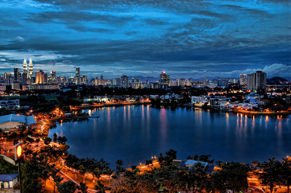 blue hour cityscape lake reflection