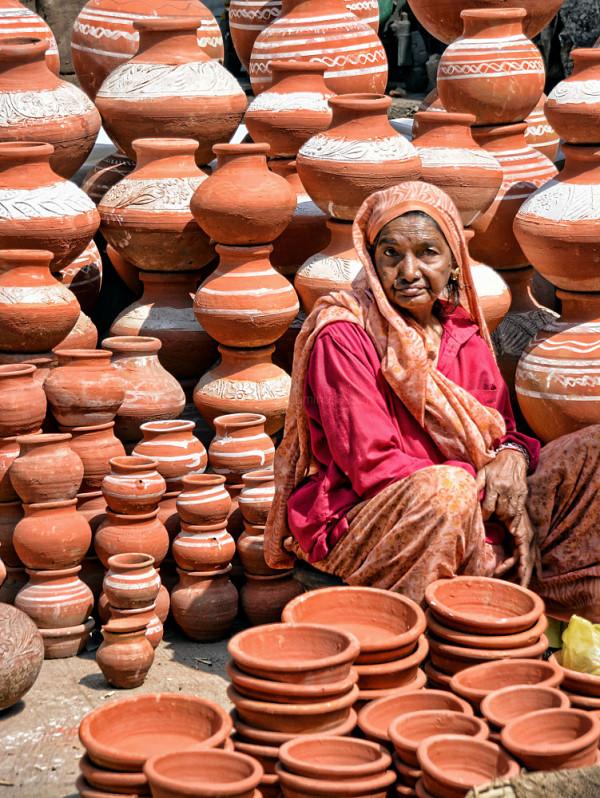 street portrait woman pottery terracotta colours