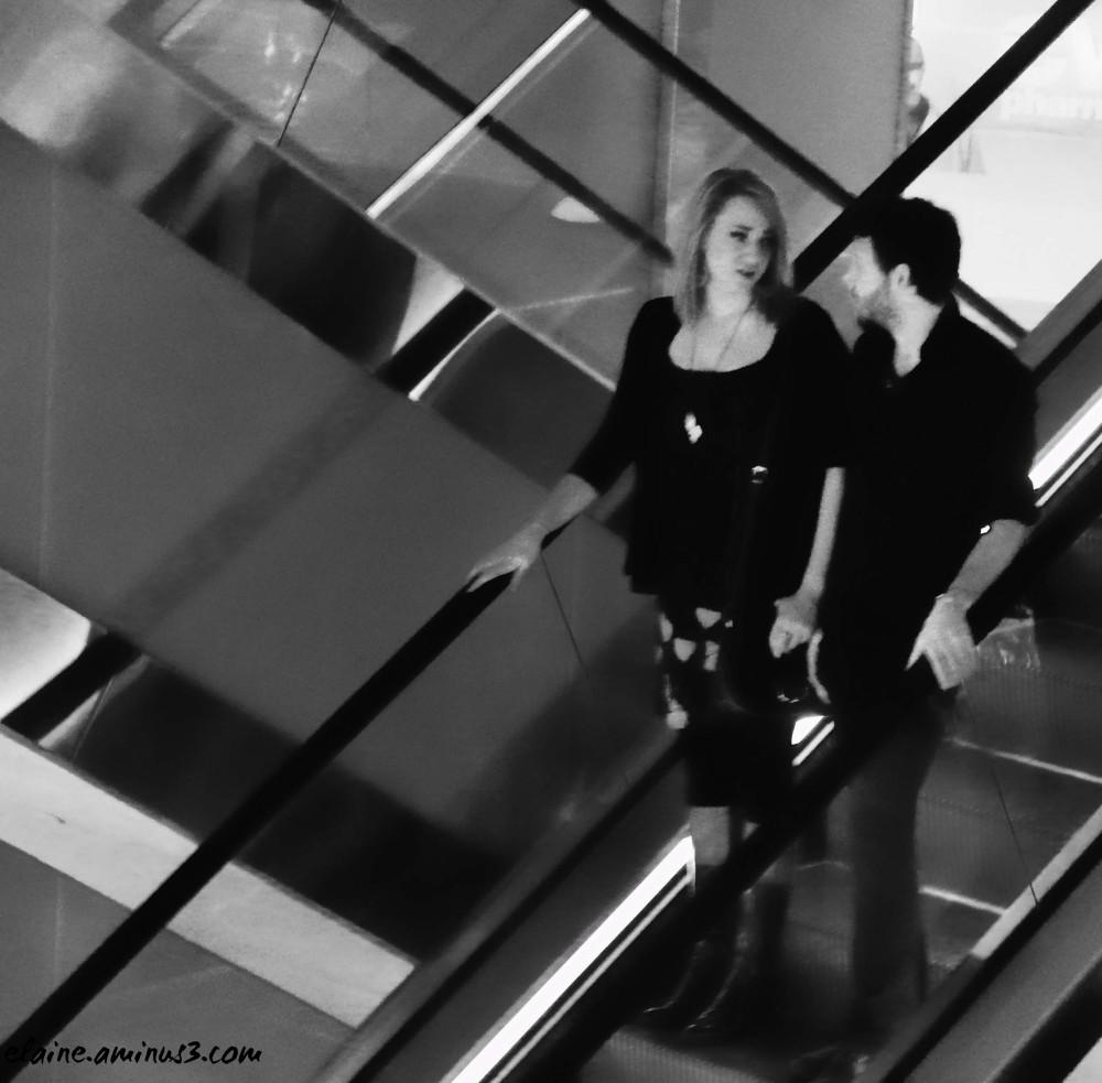 couple on an escalator